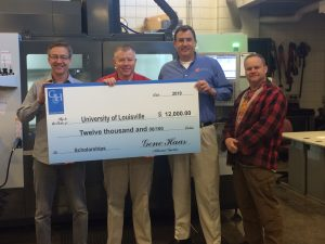 The AMIST (Additive Manufacturing Institute of Science and Technology) Core Facility team has been awarded a $12,000 grant to advance education and training in manufacturing technologies. Pictured from left: Tim Gornet, Manager, AMIST Operations; Gary Graf, Coordinator, Technical Services; Phil Haming, Sales Engineer CMTSE, HFO Midwest; Joe Vicars, Laser Development Engineering, Vogt Engineering.