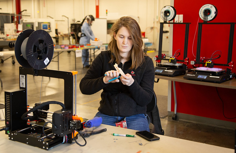 Graduate assistant and student Kate Schneidau oversees the 3D printing of face shield for local health care professionals in response to the shortage caused by the COVID-19 pandemic.