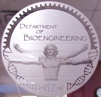 Etched Department of Bioengineering logo on door