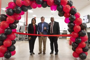 UofL President Neeli Bendapudi and Emmanuel Collins, dean of J.B. Speed School of Engineering, assist LARRI Director Dan Popa cut the ribbon to official open the 10,000 sq. ft. facility for LARRI.